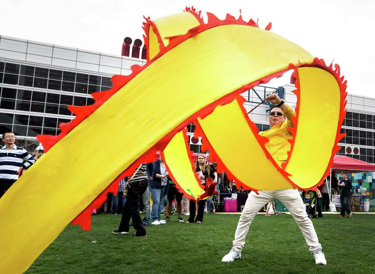 Qi Fei-Long performs with a streamer during the 19th Annual Texas Lunar New Year Celebration at Discovery Green on Saturday, Feb. 21, 2015, in Houston.