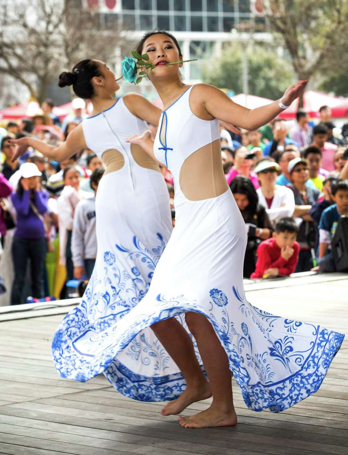 Dancers of the Flower dance troupe perform during the 19th Annual Texas Lunar New Year Celebration at Discovery Green on Saturday, Feb. 21, 2015, in Houston.
