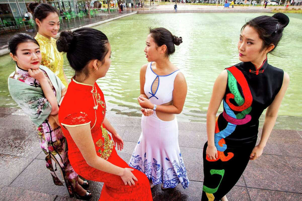 Runzhiyi Liu, from left, Jessica Laing, Cindy Yang, Alice Li and Irena Wan get ready to take the stage for a fashion show during the 19th Annual Texas Lunar New Year Celebration at Discovery Green on Saturday, Feb. 21, 2015, in Houston.