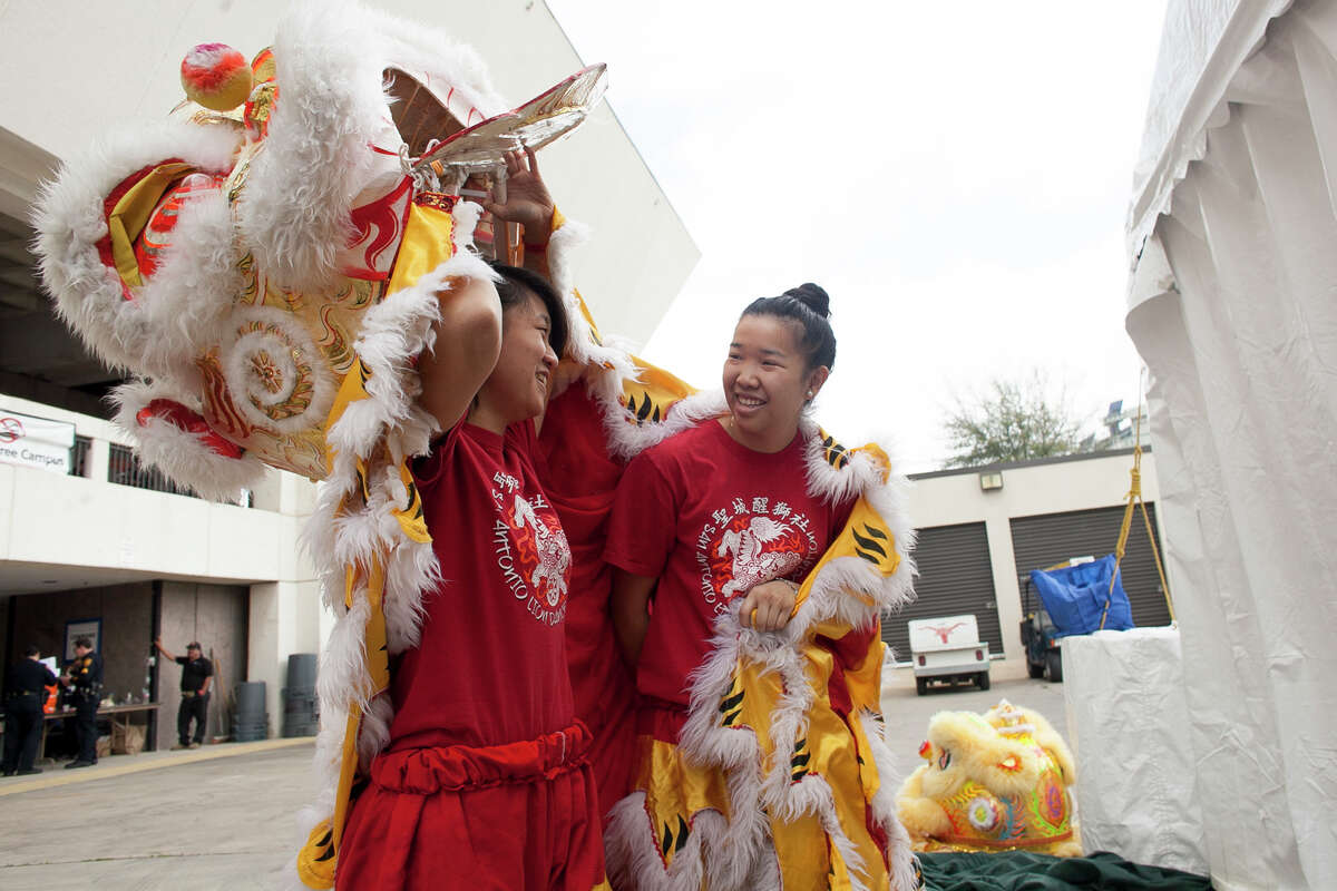 (From left) Anna Wong and Christina Lew prepare for their performance of the lion dance Saturday Feb. 21, 2015 at the 28th Annual Asian Festival. Wong and Lew have been performing at the festival for the past fourteen years.
