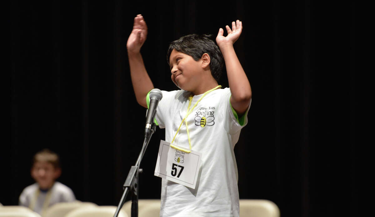 Alex Iyer of the Geneva School of Boerne reacts to spelling a word correctly during the Spelling Bee sponsored by the Express-News Saturday at Laurie Auditorium.