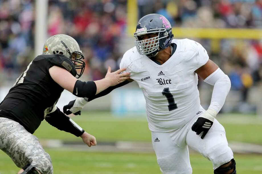 Christian Covington, right, hopes to follow former Rice teammate and Canadian countryman Luke Willson into the NFL. Photo: Gregory Payan, STF / AP