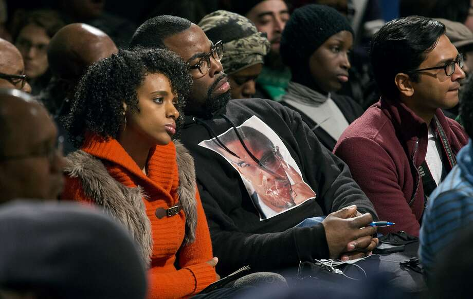 Rahiel Tesfamariam, left, and Raschaad Hoggard, both of New York, listen during comments as activists, actors, and politicians remember civil rights leader Malcolm X during a ceremony at the New York site in Harlem where he was killed 50 years ago Saturday, Feb. 21, 2015. (AP Photo/Craig Ruttle) Photo: Craig Ruttle, Associated Press