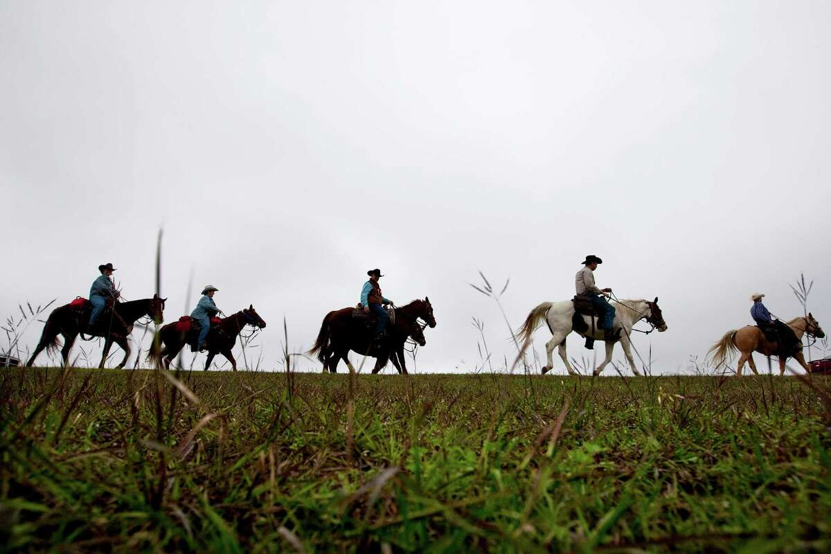 With more than 100 riders in tow, the Valley Lodge trail riders make their way down Westheimer Pkwy. through George Bush Park on their 71 mile journey from Brookshire Thursday, Feb. 23, 2012, in Houston. The group was established in 1959. ( Johnny Hanson / Houston Chronicle )