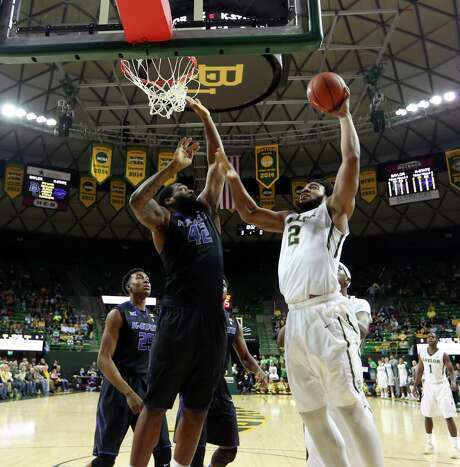 Baylor forward Rico Gathers (2) drivers to the basket over Kansas State forward Thomas Gipson (42), left, in the first half of an NCAA college basketball game, Saturday, Feb. 21, 2015, in Waco, Texas. Baylor won 69-42. (AP Photo/Rod Aydelotte) Photo: Rod Aydelotte, FRE / FRE36102AP