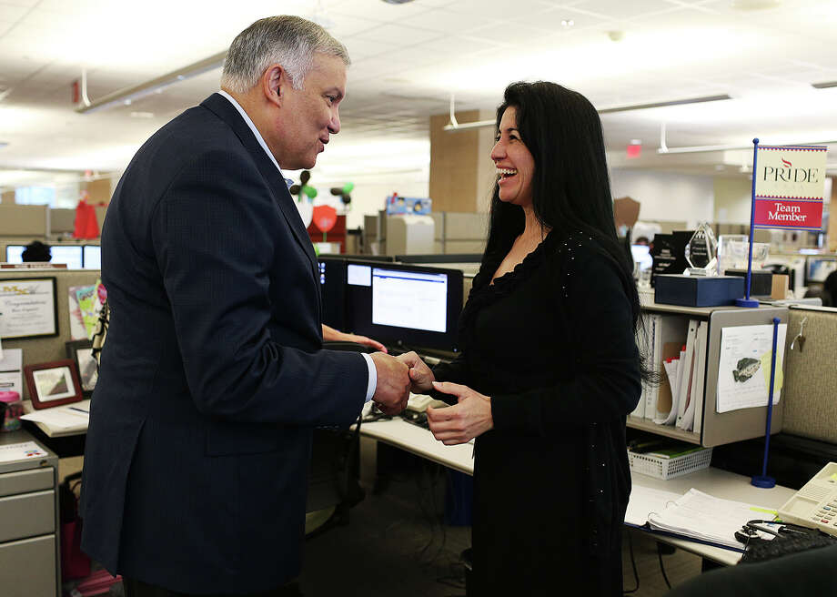 Former USAA President and CEO Joe Robles, left, talks with Tammy Green during a visit with employees of the USAA Bank Consumer Loan Department. Photo: Jerry Lara /San Antonio Express-News / © 2015 San Antonio Express-News