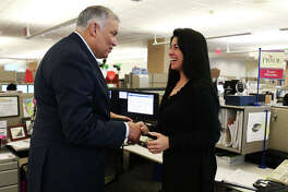 Former USAA President and CEO Joe Robles, left, talks with Tammy Green during a visit with employees of the USAA Bank Consumer Loan Department in February before his retirement. Robles assumed the position in 2007 . Robles retired as a major general in the U.S. Army in 1994 and soon after joined USAA.