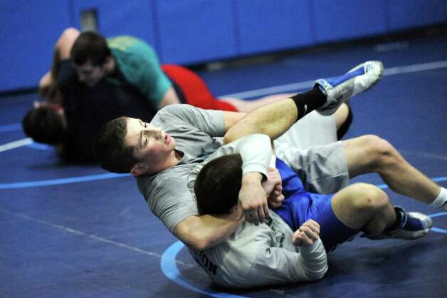 Columbia's Matt McHugh, center, grapples with Hoosick Falls' Colby Davendonis during practice on Friday, Feb. 20, 2015, at Columbia High in East Greenbush, N.Y. (Cindy Schultz / Times Union) Photo: Cindy Schultz / 00030675A