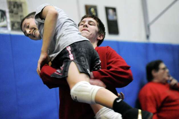 LaSalle's Trent Nadeau, center, lifts Columbia's Michael Gonyea during wrestling practice on Friday, Feb. 20, 2015, at Columbia High in East Greenbush, N.Y. (Cindy Schultz / Times Union) Photo: Cindy Schultz / 00030675A