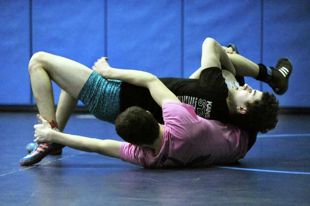 Hoosick Falls' Nolan Foster, top, grapples with Columbia's John DeVine during practice on Friday, Feb. 20, 2015, at Columbia High in East Greenbush, N.Y. (Cindy Schultz / Times Union) Photo: Cindy Schultz / 00030675A