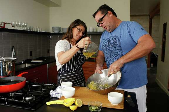 Chefs Dona Savitsky and Thomas Schnetz, who opened Doña Tomás in Oakland 15 years ago, make aioli in their kitchen at home in Oakland.