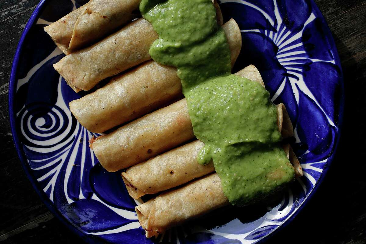 Crab taquitos with aioli and covered with avocado salsa by chefs Dona Savitsky and Thomas Schnetz of Doña Tomás restaurant.