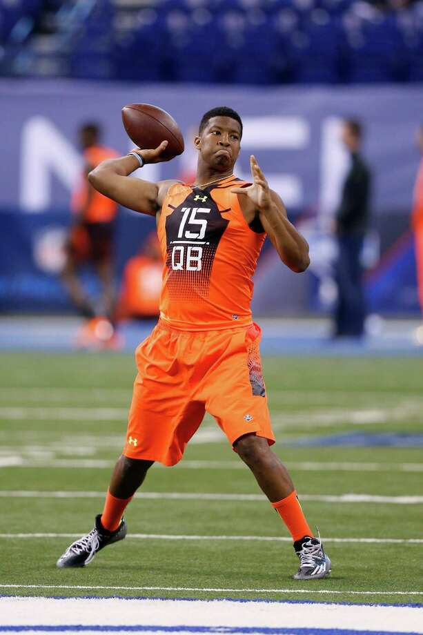 Florida State's Jameis Winston, left, and Oregon's Marcus Mariota displayed their quarterbacking talents at the NFL scouting combine on Saturday, with Winston completing all 16 of his attempts and Mariota going 13-of-15. Photo: Joe Robbins, Stringer / 2015 Getty Images