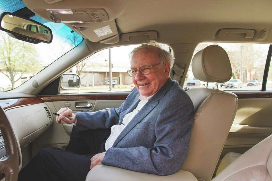 This photo provided by Proxibid shows Warren Buffett inside his  2006 Cadillac DTS.   Buffett  car was auctioned for more than $122,000, about 10 times the estimated worth, as the billionaire and philanthropist offered to again help out one of his favorite charities. Buffett put the car  for sale on the website Proxibid, specifying that the money would be donated to Girls Inc. of Omaha. The car, valued at about $12,000 went for a final bid of $122,500 on Thursday, Feb. 19, 2015. (AP Photo/Proxibid, Paige Stark) Photo: Paige Stark, HONS / Proxibid