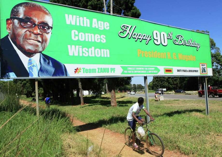 Last year, a billboard wished Zimbabwean President Robert Mugabe a happy 90th birthday. He will turn 91 on Saturday. Photo: Tsvangirayi Mukwazhi, STR / AP