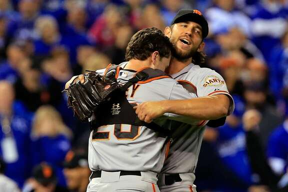 KANSAS CITY, MO - OCTOBER 29:  Buster Posey #28 and Madison Bumgarner #40 of the San Francisco Giants celebrate after defeating the Kansas City Royals to win Game Seven of the 2014 World Series by a score of 3-2 at Kauffman Stadium on October 29, 2014 in Kansas City, Missouri.  (Photo by Jamie Squire/Getty Images)
