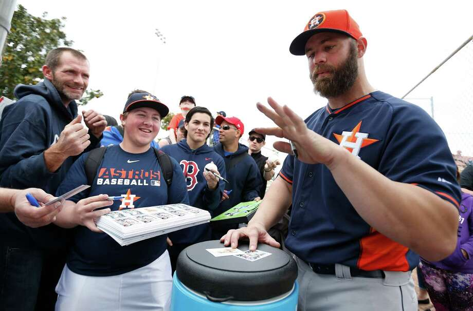 It wasn't writer's cramp that got the attention of Astros catcher Evan Gattis but rather how much ink he had on his hand after signing autographs Saturday. Photo: Karen Warren, Staff / © 2015 Houston Chronicle