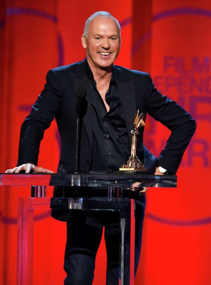 """Michael Keaton accepts the award for best male lead for """"Birdman or (The Unexpected Virtue of Ignorance)"""" at the 30th Film Independent Spirit Awards on Saturday, Feb. 21, 2015, in Santa Monica, Calif. (Photo by Chris Pizzello/Invision/AP) Photo: Chris Pizzello, INVL / Invision"""