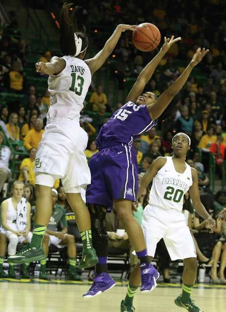 Baylor's Nina Davis (13) blocks the shot of TCU's Jada Butts in the first half - one of nine blocked shots by the No. 3 Lady Bears in their 91-75 victory. Photo: Jerry Larson, FRE / FR91203 AP