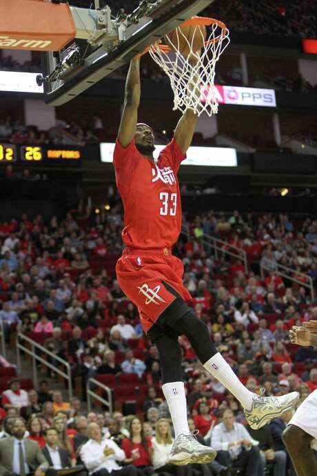 New Rockets Pablo Prigioni and KJ McDaniels watched as guard Corey Brewer, who came to Houston in a trade earlier this season, poured in 26 points to lead Houston past Toronto on Saturday night at Toyota Center. Photo: Gary Coronado, Staff / © 2015 Houston Chronicle