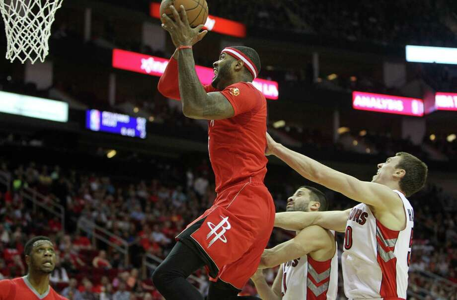 Rockets reserve Josh Smith leaves the Raptors behind en route to the basket. The Rockets' bench outscored its counterparts 48-17 to make a decisive difference. Photo: Gary Coronado, Staff / © 2015 Houston Chronicle