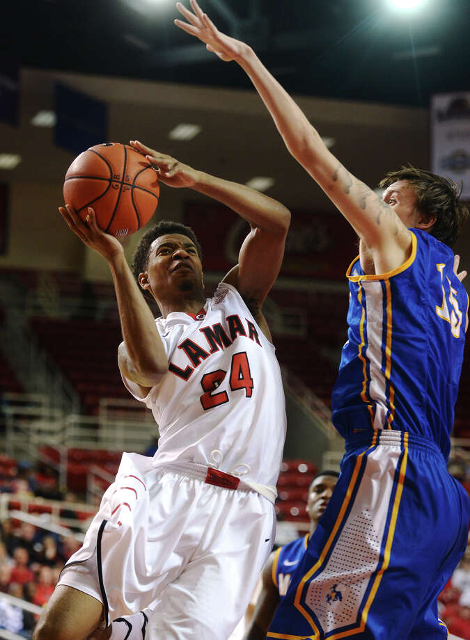 Lamar's Quan Jones, No. 24, looks for a shot during Saturday's game against McNeese. The Lamar Cardinals hosted the McNeese State Cowboys at the Montagne Center on Saturday night. Photo taken Saturday 2/21/15 Jake Daniels/The Enterprise Photo: Jake Daniels / ©2014 The Beaumont Enterprise/Jake Daniels