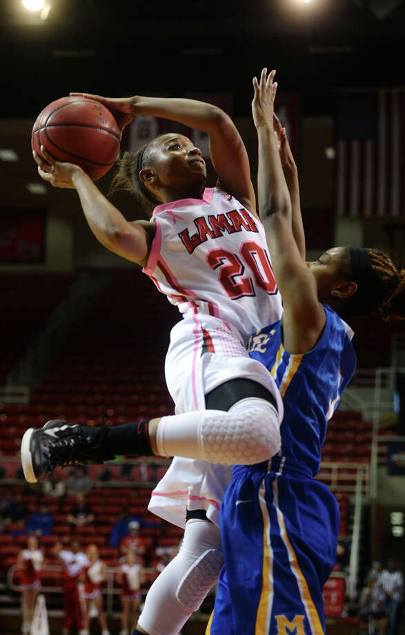 Lamar's JaMeisha Edwards, No. 20, goes up for a shot during Saturday's game against McNeese. The Lamar Lady Cardinals hosted the McNeese State Cowgirls at the Montagne Center on Saturday night. Photo taken Saturday 2/21/15 Jake Daniels/The Enterprise Photo: Jake Daniels / ©2014 The Beaumont Enterprise/Jake Daniels