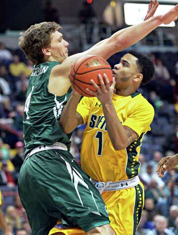 Siena's #1 Marquis Wright, right, and Manhattan's #4 Zane Waterman during a MAAC game at the Times Union Center Saturday Feb. 21, 2015 in Albany, NY.  (John Carl D'Annibale / Times Union) Photo: John Carl D'Annibale / 00030520C