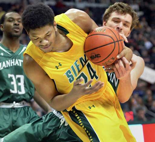 Siena's #24 Lavon Long, left, wrestles the ball from Manhattan's #4 Zane Waterman during a MAAC game at the Times Union Center Saturday Feb. 21, 2015 in Albany, NY.  (John Carl D'Annibale / Times Union) Photo: John Carl D'Annibale / 00030520C