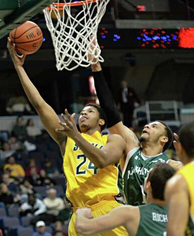 Siena's #24 Lavon Long, left, gets past Manhattan's #1 Ashton Pankey as he goes to the basket during a MAAC game at the Times Union Center Saturday Feb. 21, 2015 in Albany, NY.  (John Carl D'Annibale / Times Union) Photo: John Carl D'Annibale / 00030520C