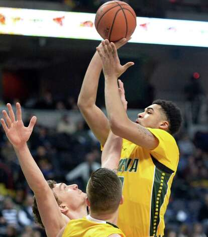 Siena's #0Javion Ogunyemi gets a shot off during Saturday's MAAC game against Manhattan at the Times Union Center Saturday Feb. 21, 2015 in Albany, NY.  (John Carl D'Annibale / Times Union) Photo: John Carl D'Annibale / 00030520C
