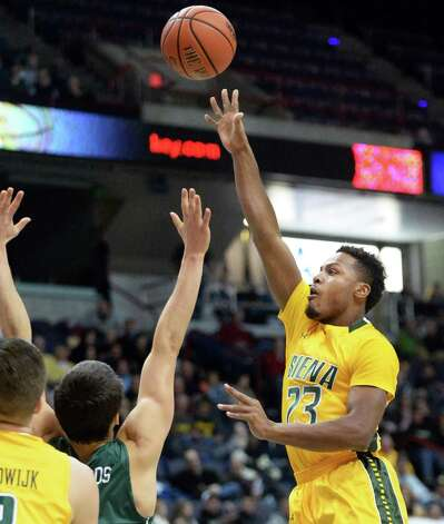 Siena's #23 Maurice White, right, gets a shot off during Saturday's MAAC game against Manhattan at the Times Union Center Saturday Feb. 21, 2015 in Albany, NY.  (John Carl D'Annibale / Times Union) Photo: John Carl D'Annibale / 00030520C