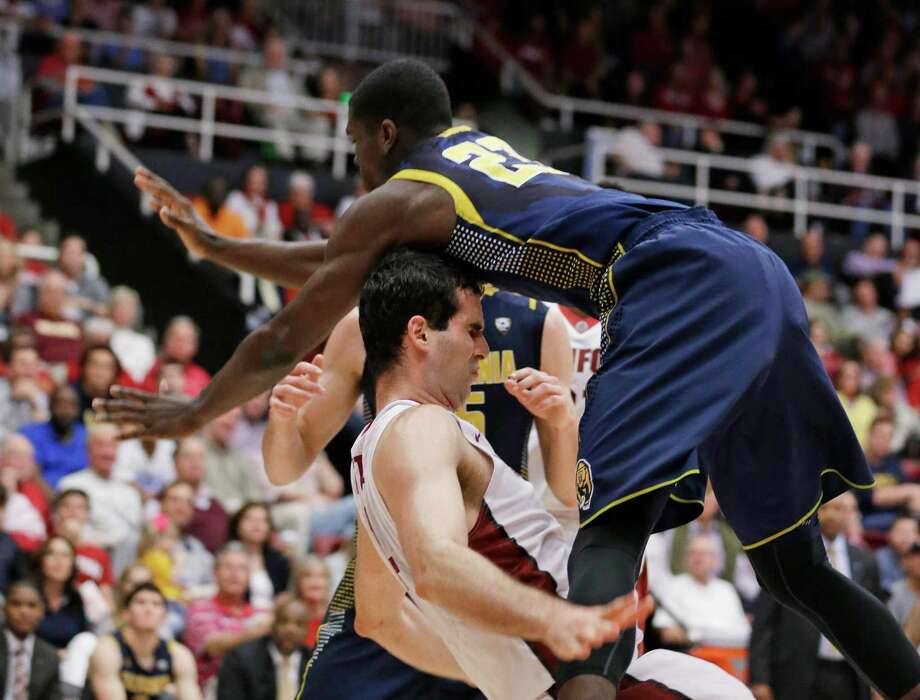 Cal guard Jabari Bird falls onto Stanford center Stefan Nastic while going to the basket during the second half of the Cardinal's 72-61 victory at Maples Pavilion. Photo: Eric Risberg / Associated Press / AP