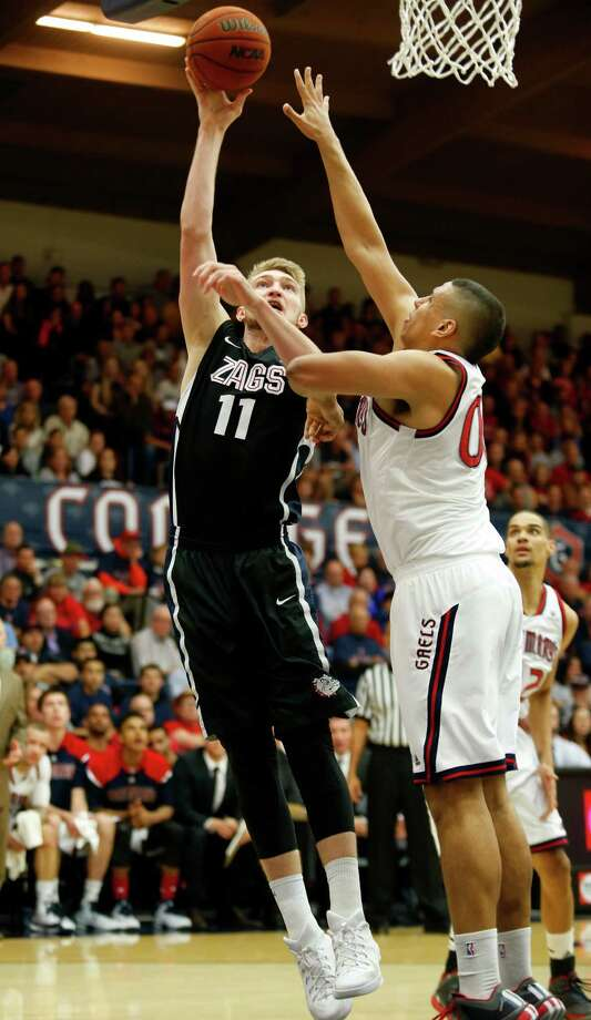 Gonzaga forward Domantas Sabonis (left) shoots over St. Mary's forward Brad Waldow during the first half at McKeon Pavilion. Photo: Beck Diefenbach / Associated Press / FR170639 AP