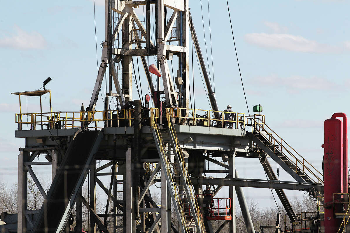 Work continues on a drilling rig off Texas State Highway 72 east of Tilden, Texas, Thursday, February, 19, 2015.