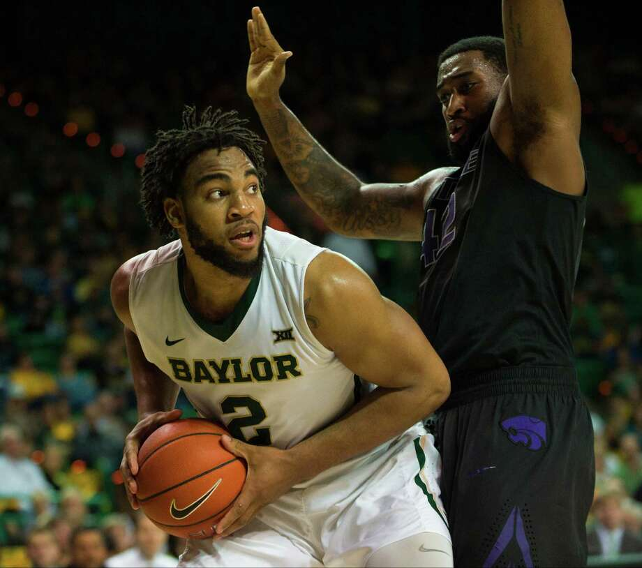 WACO, TX - FEBRUARY 21: Rico Gathers #2 of the Baylor Bears drives to the basket against Thomas Gipson #42 of the Kansas State Wildcats on February 21, 2015 at the Ferrell Center in Waco, Texas. Photo: Cooper Neill, Getty Images / 2015 Getty Images