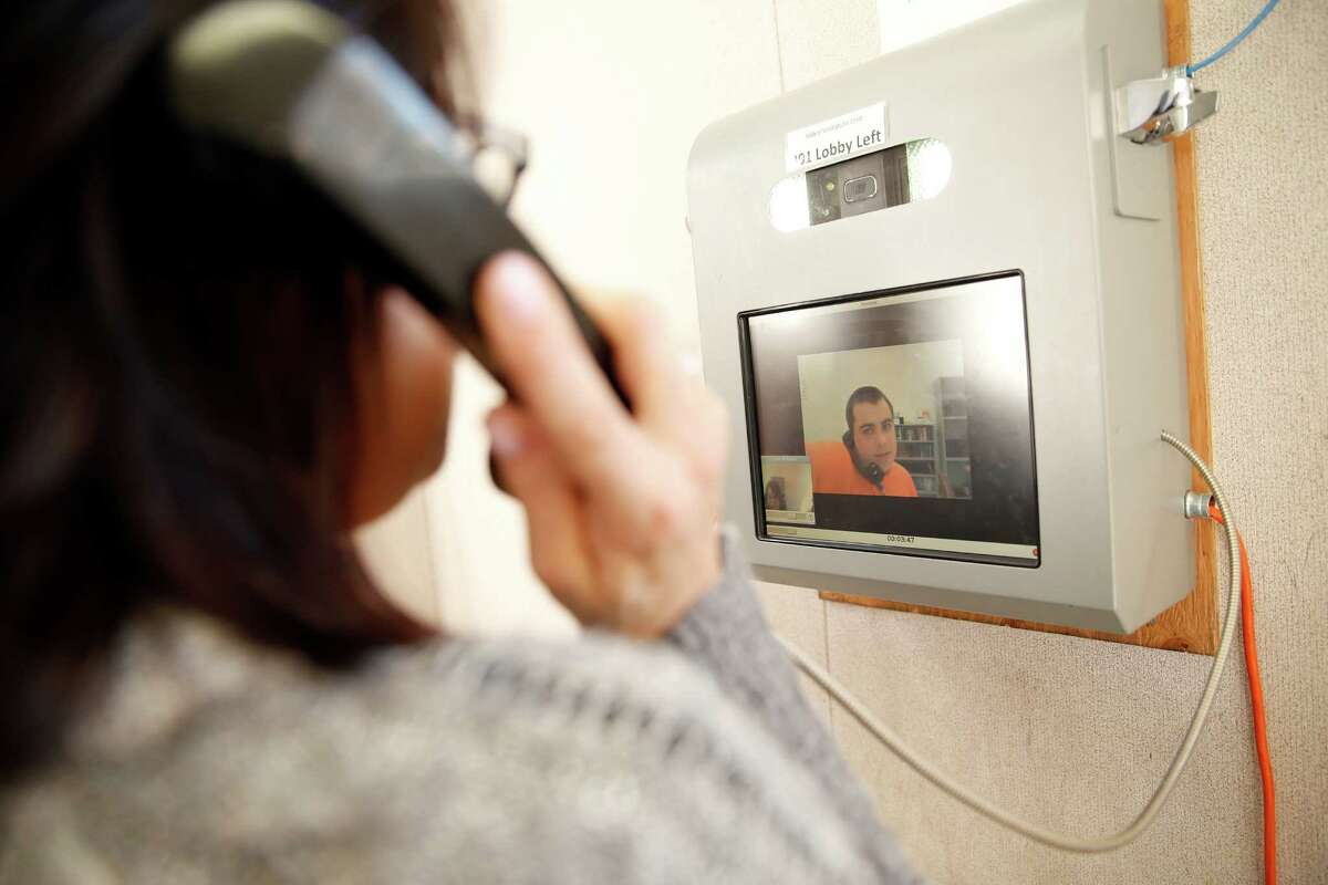 Jennifer Walter does a video visit with her son Ryan Thurow, 21, from a trailer in the parking lot of the Napa County Corrections Dept. County Jail in Napa.