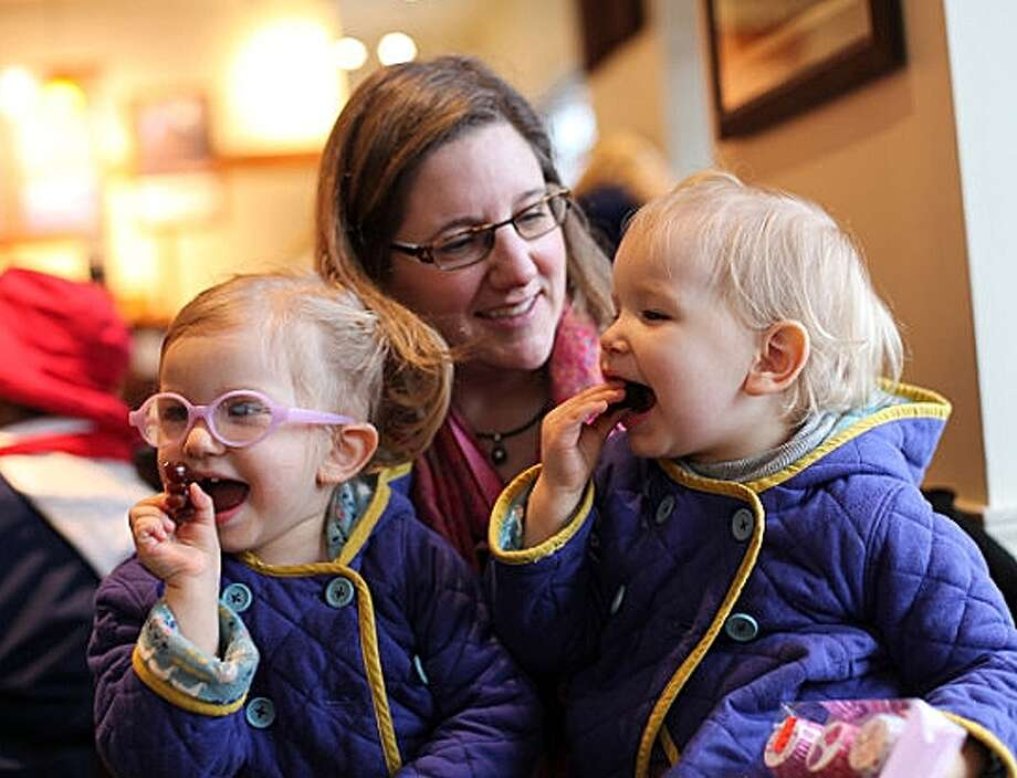 In a Feb. 9, 2015 photo, Michelle Moore poses for a photo with her twin daughters, Sierra, right,  and Savannah in Lake Oswego, Ore. Moore is not opposed to medicine, thinks vaccines have a place and are a medical choice that should be researched carefully. Moore is among the vaccine skeptics who have been widely ridiculed since more than 100 people fell ill in a measles outbreak traced to Disneyland. Photo: Gosia Wozniacka, AP / AP