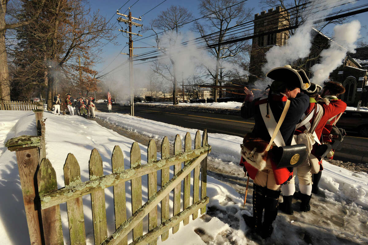 Reenactors with the 5th Connecticut Regiment, at left, and members of His Majesty's 54th Regiment fire at one another during the Putnam Hill Park Rededication and American Revolutionary War Reenactment at Putnam Cottage in Greenwich, Conn., on Sunday, Feb. 22, 2015.
