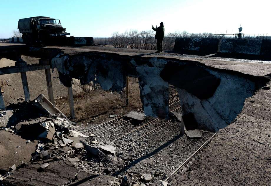 A pro-Russian separatist's truck drives along a damaged bridge in the eastern Ukrainian city of Debaltseve in the Donetsk region. Photo: VASILY MAXIMOV / AFP / Getty Images / AFP