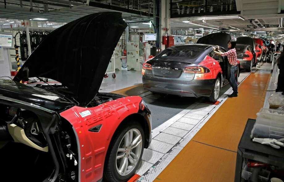 Working the assembly line at Tesla Motors, California's only full-scale auto manufacturing plant, as seen on Thurs. Feb. 19, 2015,  in Fremont, Calif. Photo: Michael Macor, Staff / ONLINE_YES