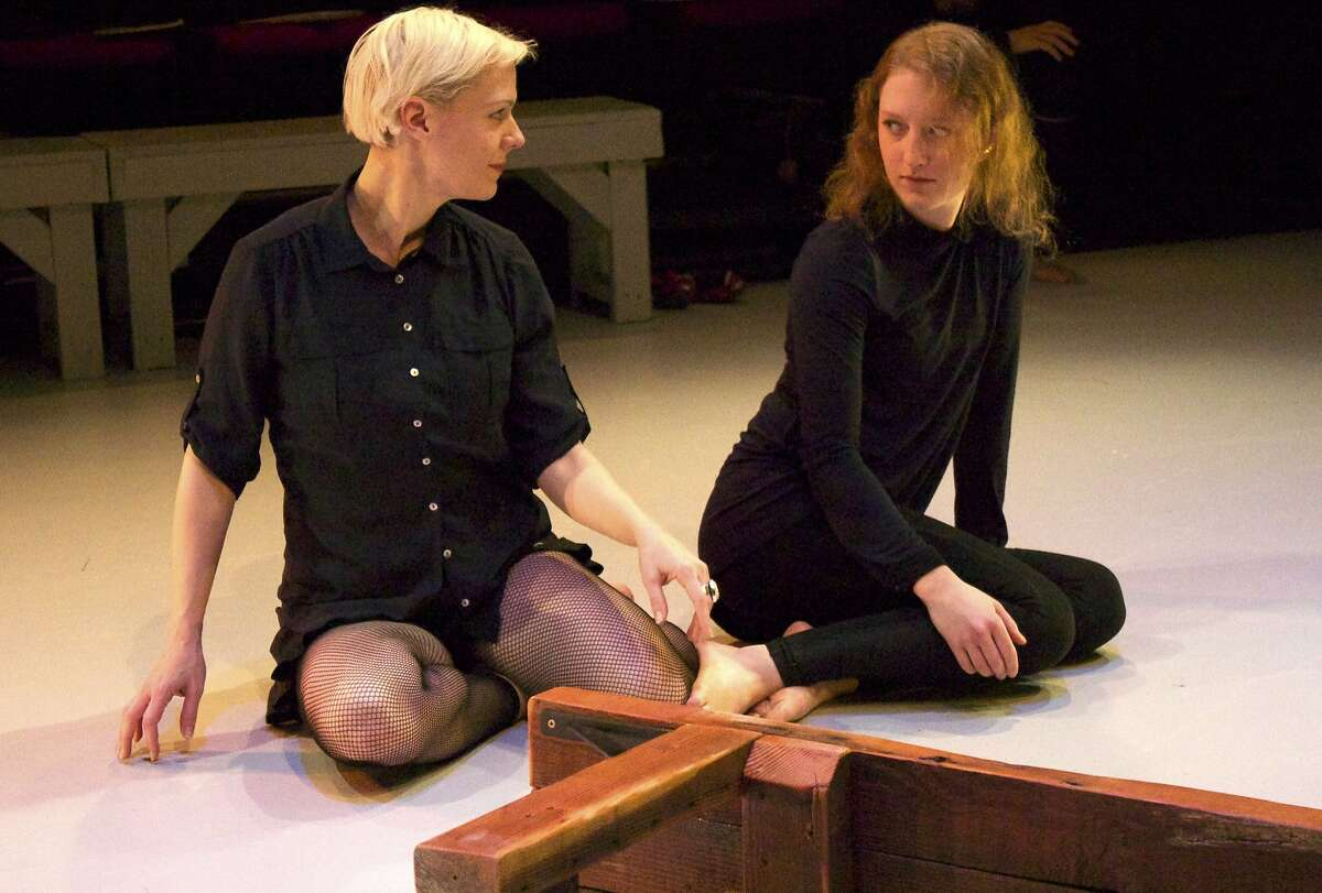 Antigone (Madeline H.D. Brown, left) talks with her sister Ismene (Hannah Donovan) in Cutting Ball's produciton of