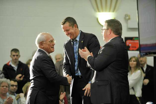 Congressman Paul Tonko, left, talk with Albany County Sheriff Craig Apple, center, and Albany County Executive Daniel McCoy after Tonko expressed his support for both men during a campaign event  at the Albany Labor Temple on Sunday, Feb. 22, 2015, in Albany, N.Y.   Apple and  McCoy held the joint event to announced their re-election campaigns.  (Paul Buckowski / Times Union) Photo: PAUL BUCKOWSKI / 00030716A