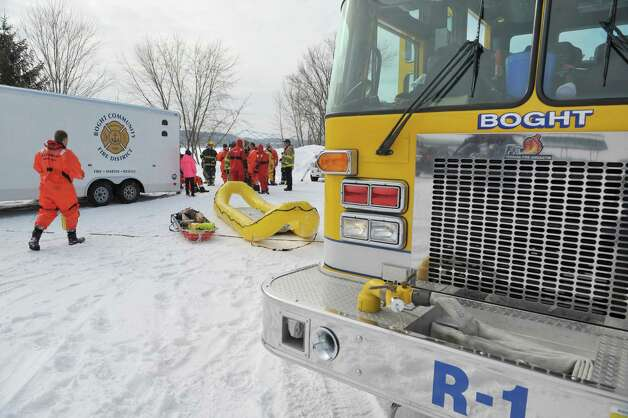 Members of the Boght Community Fire Department, Halfmoon-Waterford Fire Department and the West Crescent Fire Department take part in a cold weather water rescue drill on the Mohawk River on Sunday, Feb. 22, 2015, in Clifton Park, N.Y.    (Paul Buckowski / Times Union) Photo: PAUL BUCKOWSKI / 00030717A