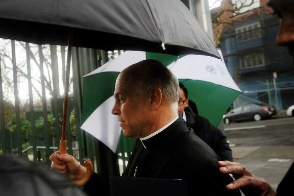 San Francisco Archbishop Salvatore Cordileone is whisked into Sacred Heart Cathedral Preparatory in San Francisco for a lecture and a question-and-answer session with teachers Feb. 6.