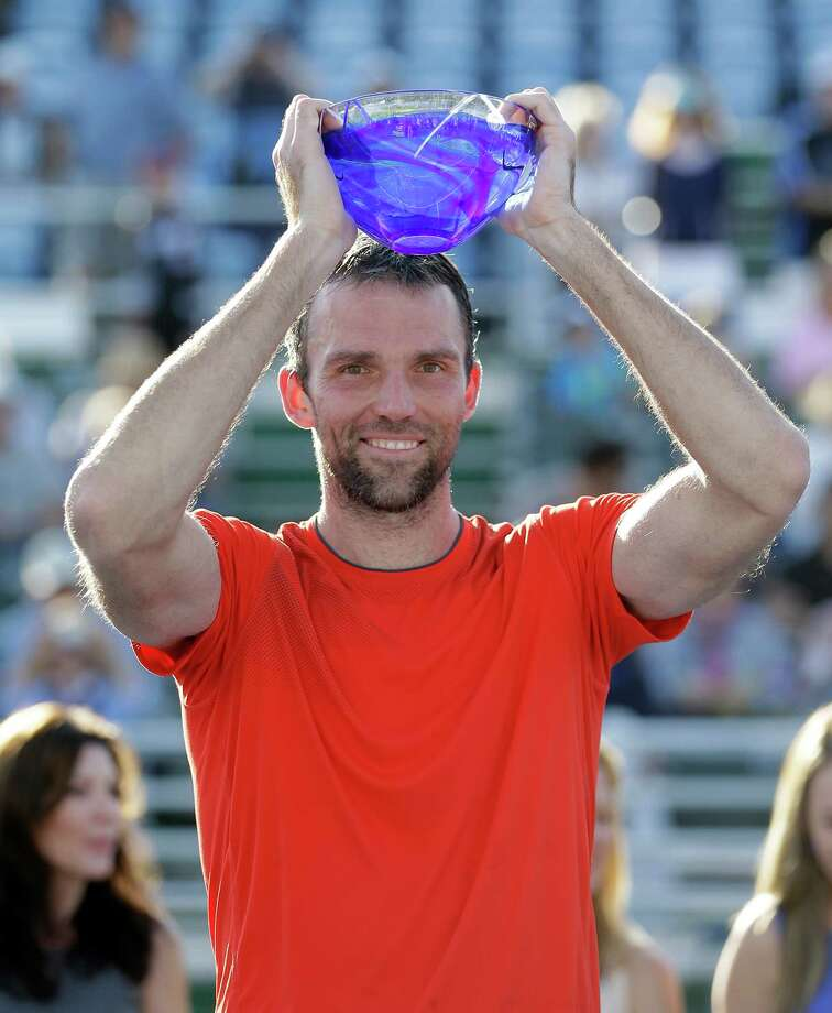 Ivo Karlovic, of Croatia, raises his trophy after winning 6-3, 6-3 over Donald Young during the final tennis match at the Delray Beach Open, in Delray Beach, Fla., Sunday, Feb. 22, 2015. (AP Photo/Alan Diaz) ORG XMIT: FLAD116 Photo: Alan Diaz / AP