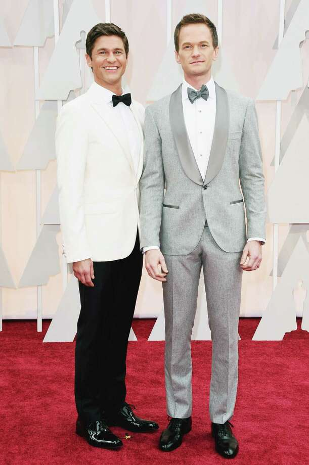 Host Neil Patrick Harris, right, and his actor/husband David Burtka both wore custom tuxedo shirts by Houston-based Hamilton Shirts on the red carpet at the 87th Annual Academy Awards. Photo: Jason Merritt, Getty Images / 2015 Getty Images