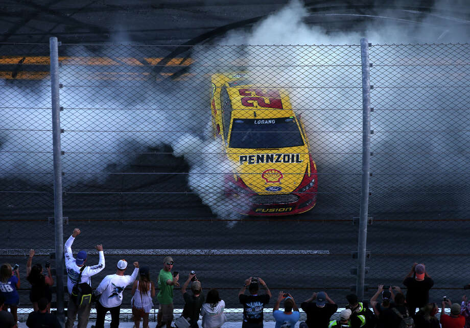 Joey Logano, driver of the #22 Shell Pennzoil Ford, celebrates with a burnout after winning the NASCAR Sprint Cup Series 57th Annual Daytona 500 at Daytona International Speedway on February 22, 2015 in Daytona Beach, Florida. (Photo by Sean Gardner/Getty Images) Photo: Sean Gardner / Getty Images / 2015 Getty Images