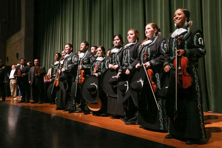 The Southwest High School Mariachi Los Dragones recieve their fifth place award in the 2015 Texas High School Mariachi Competition Finals at Southwest High School on Saturday, Feb. 7, 2015.  MARVIN PFEIFFER/ mpfeiffer@express-news.net Photo: Marvin Pfeiffer, Staff / San Antonio Express-News / Express-News 2015