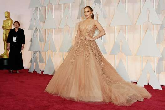 Jennifer Lopez in the biggest dress of the night: a nude colored plunging gown featuring a voluminous ball gown skirt loaded with layers and layers of beaded tulle. The gown isn't what I expected La Lopez, also wearing a ponytail, to wear to the Oscars. She actually looked like she was going to a prom, not the Academy Awards. Photo: Jason Merritt /Getty Images / 2015 Getty Images